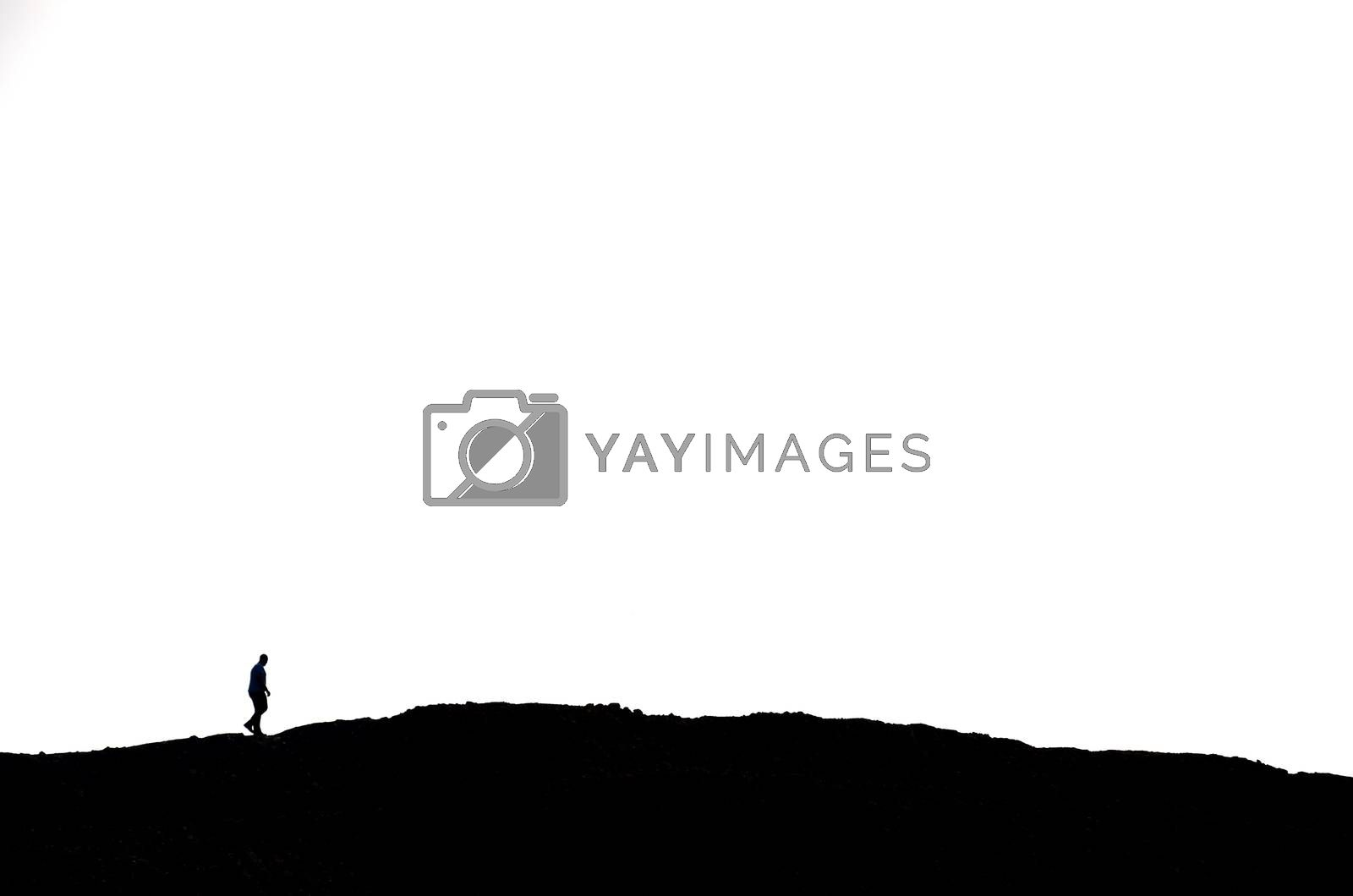 man hiking on a mountain in black with white background