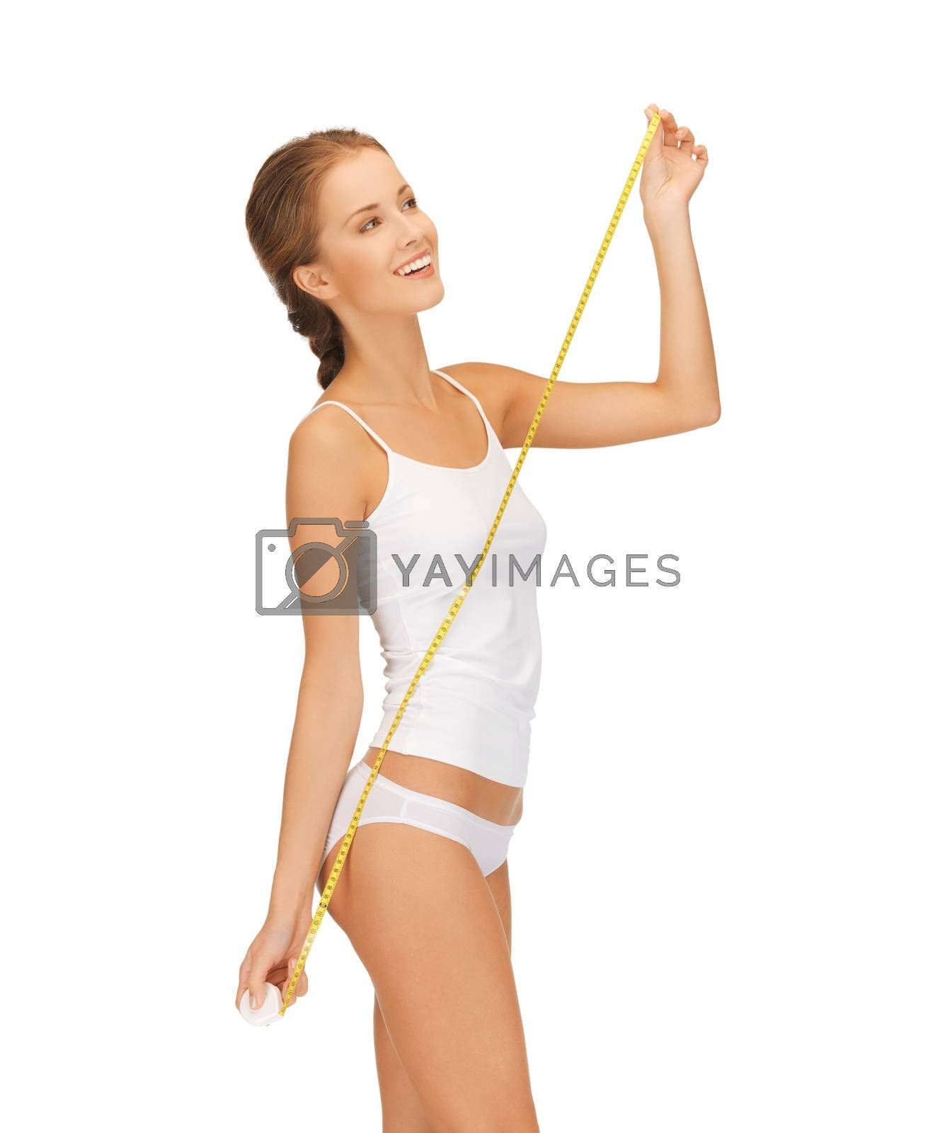 happy woman with measuring tape by dolgachov