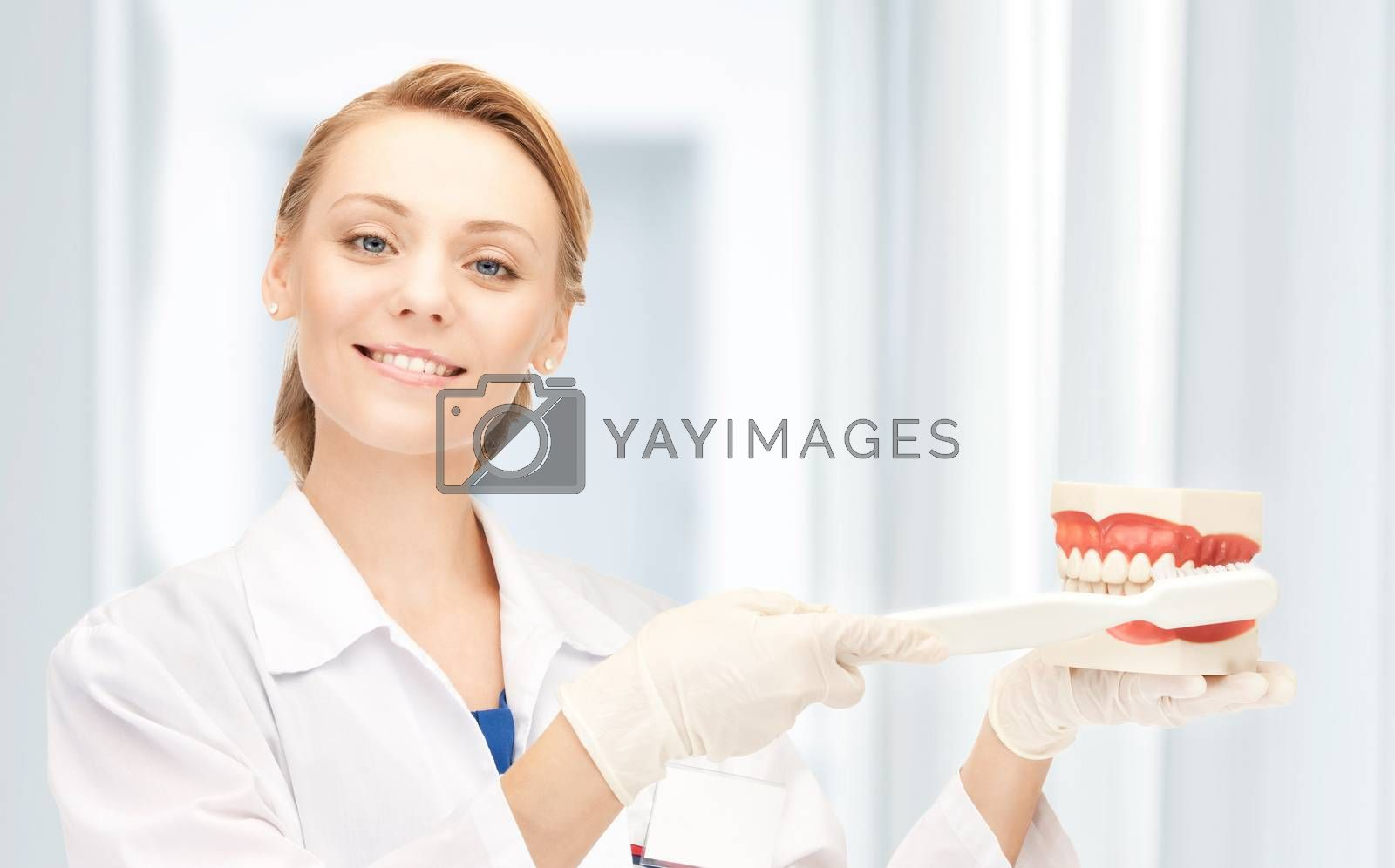 doctor with toothbrush and jaws by dolgachov