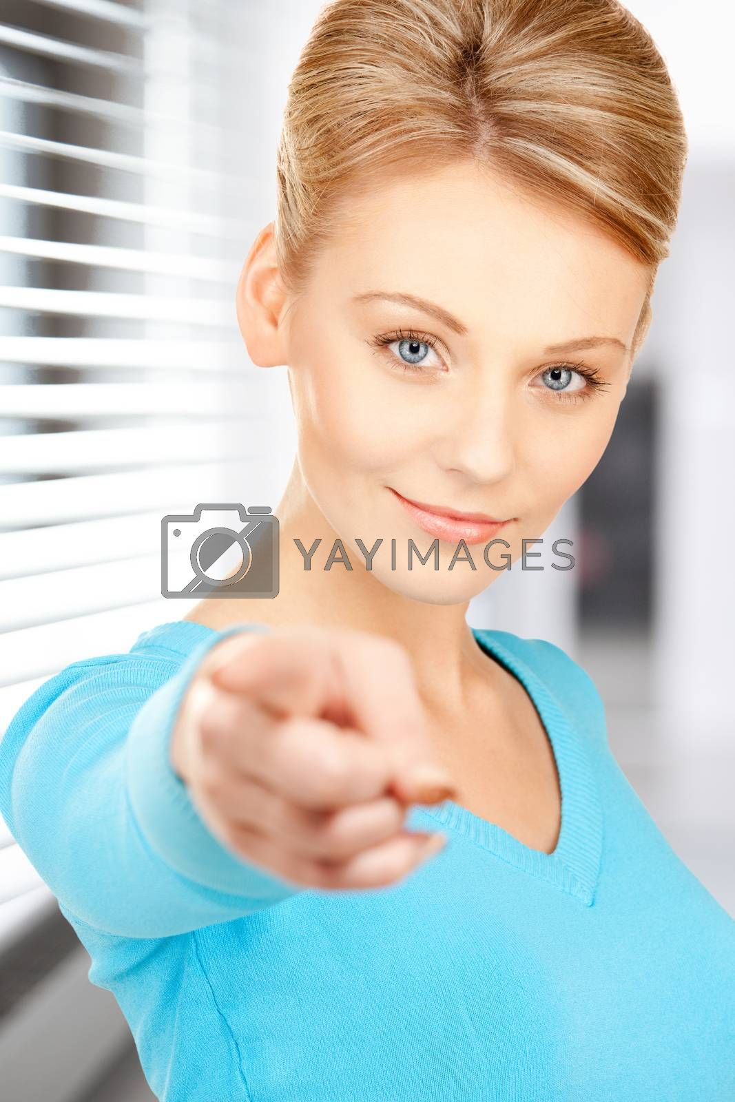 businesswoman pointing her finger by dolgachov