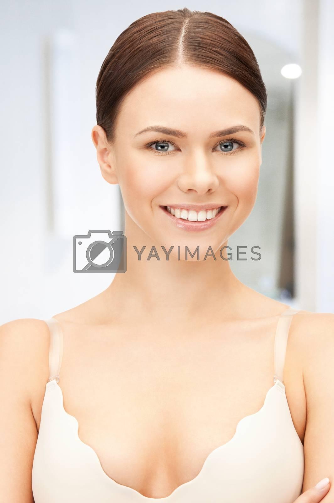beautiful woman in bra by dolgachov
