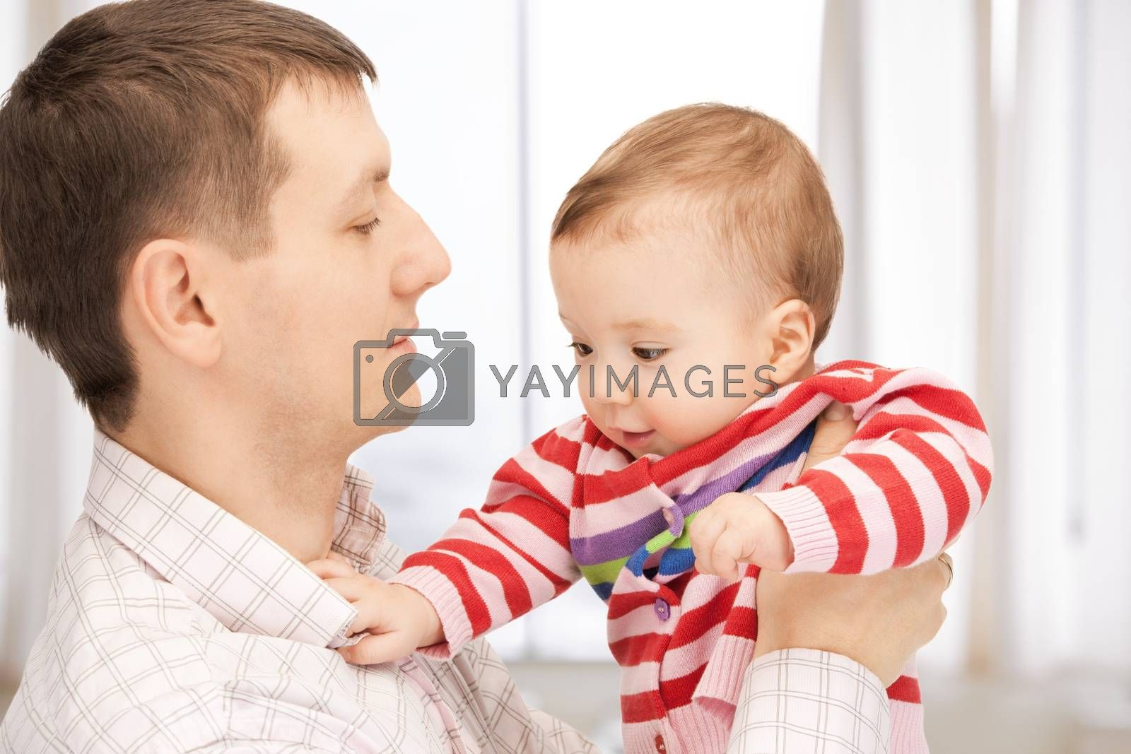 happy father with adorable baby by dolgachov