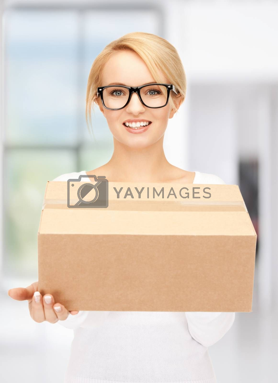 attractive businesswoman with cardboard box by dolgachov