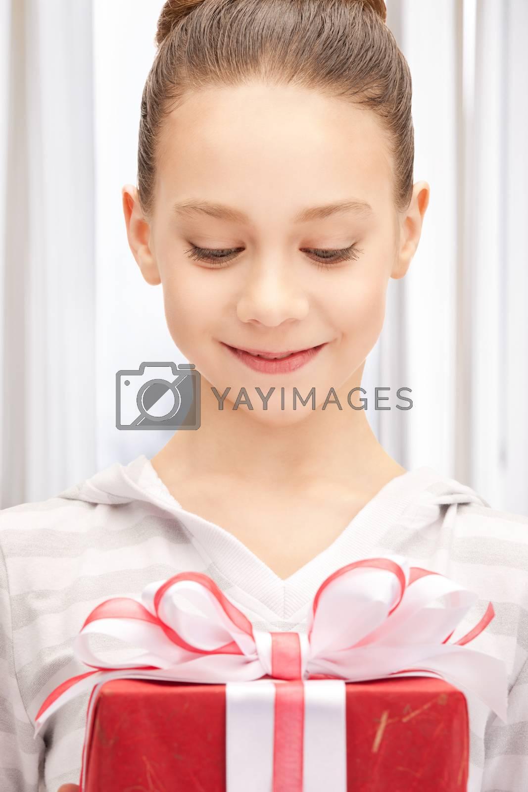 happy teenage girl with gift box by dolgachov