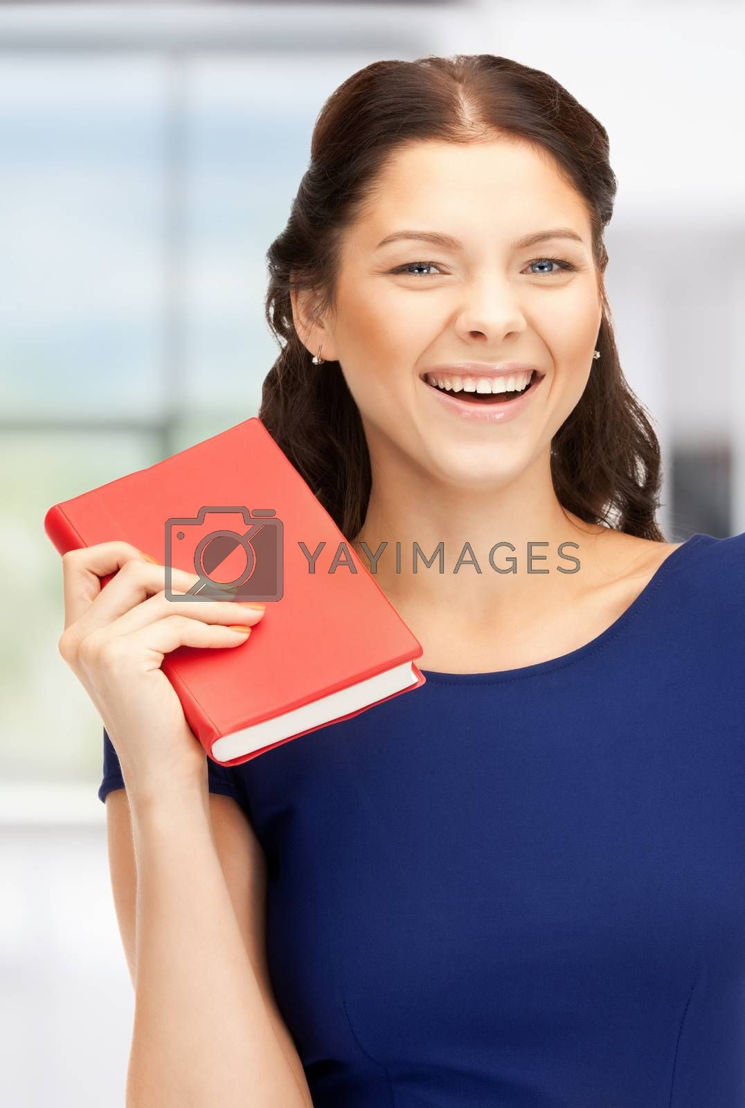 happy and smiling woman with book by dolgachov
