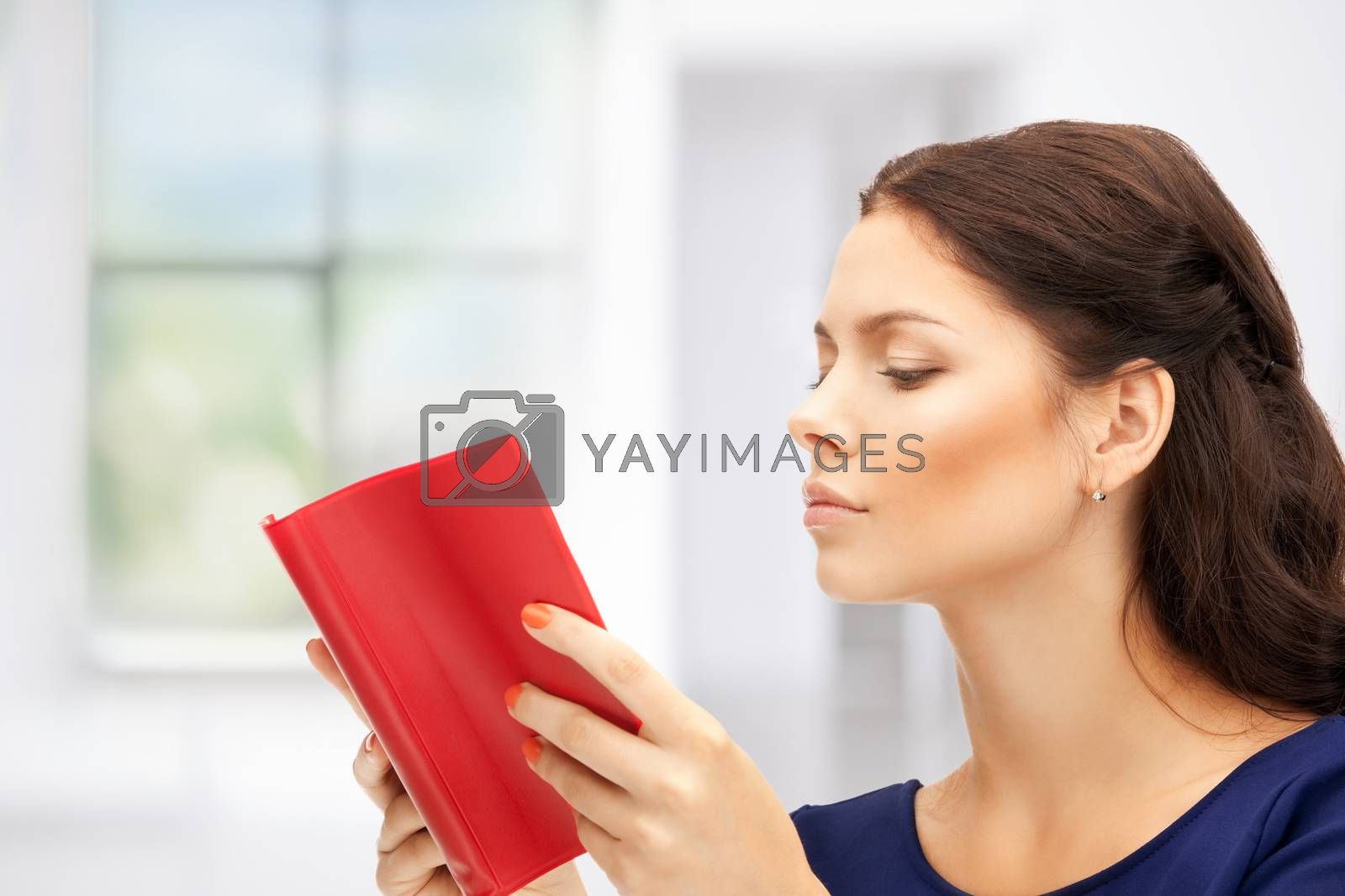 calm and serious woman with book by dolgachov