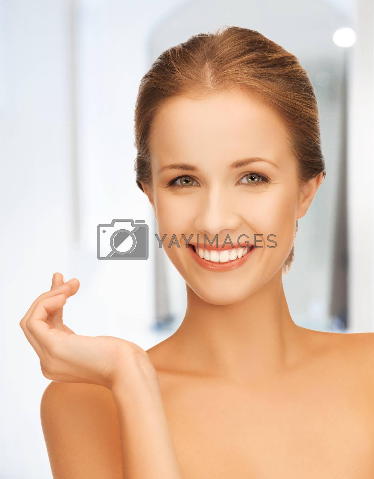 beautiful woman with moisturizing creme drop by dolgachov