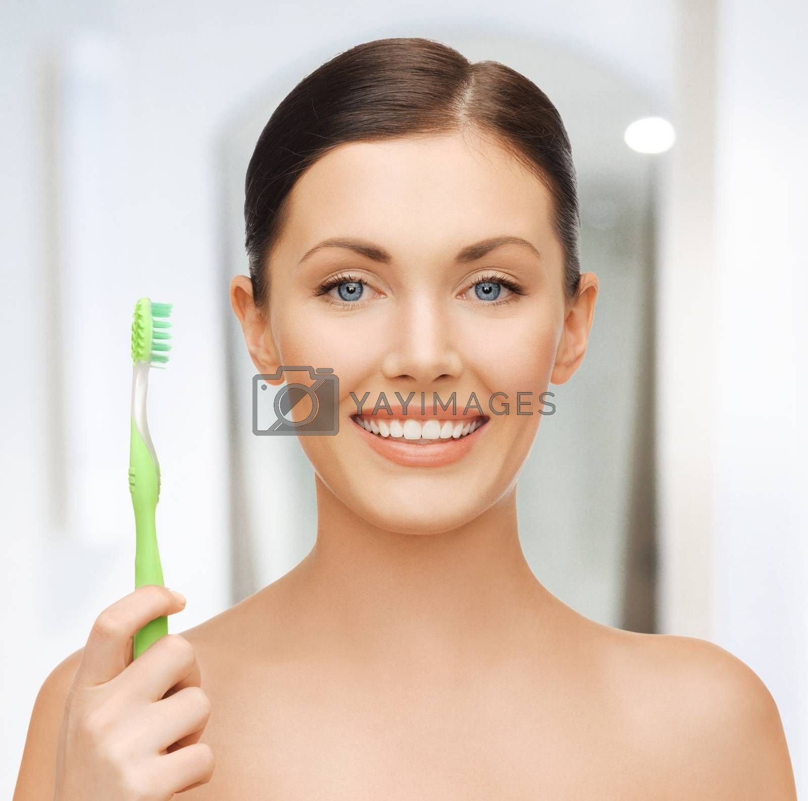 woman with toothbrush by dolgachov