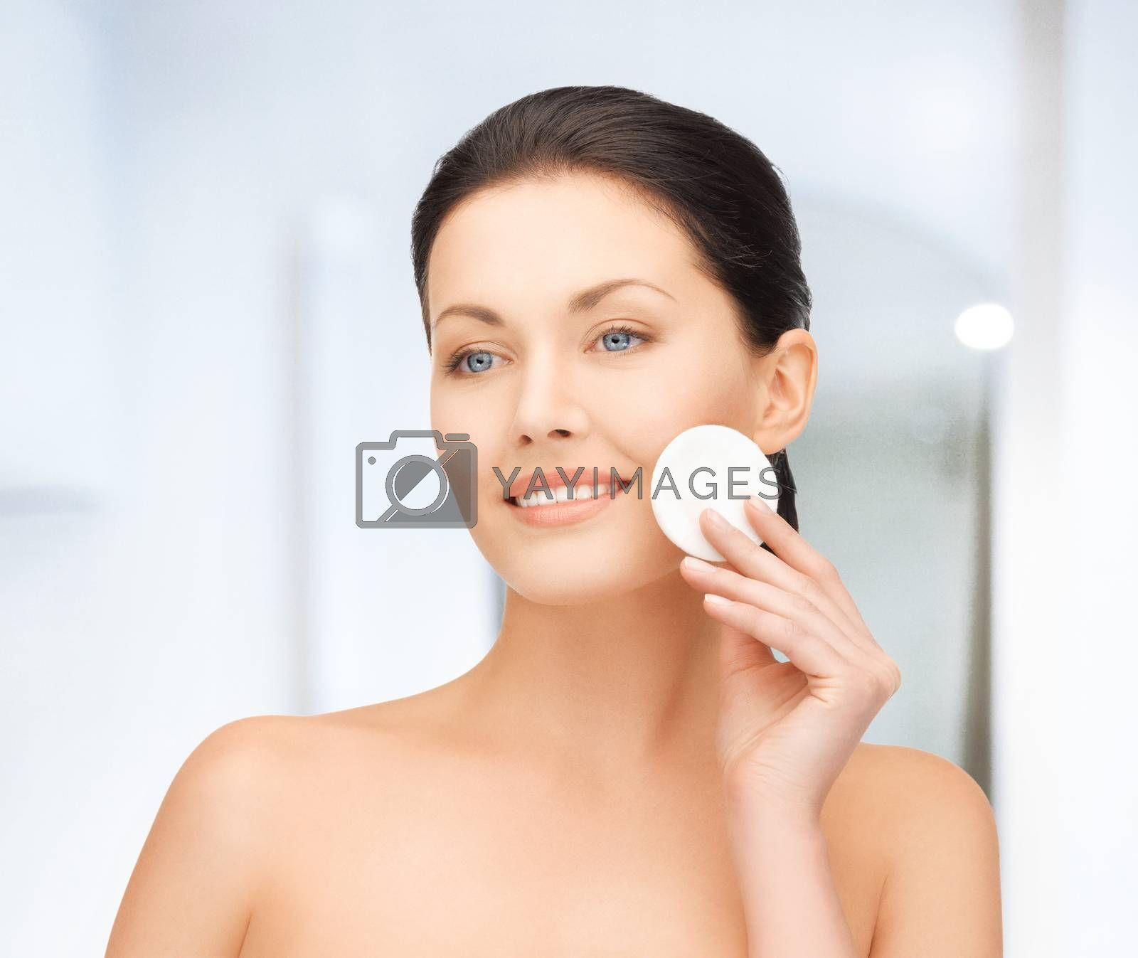 beautiful woman with cotton pad by dolgachov