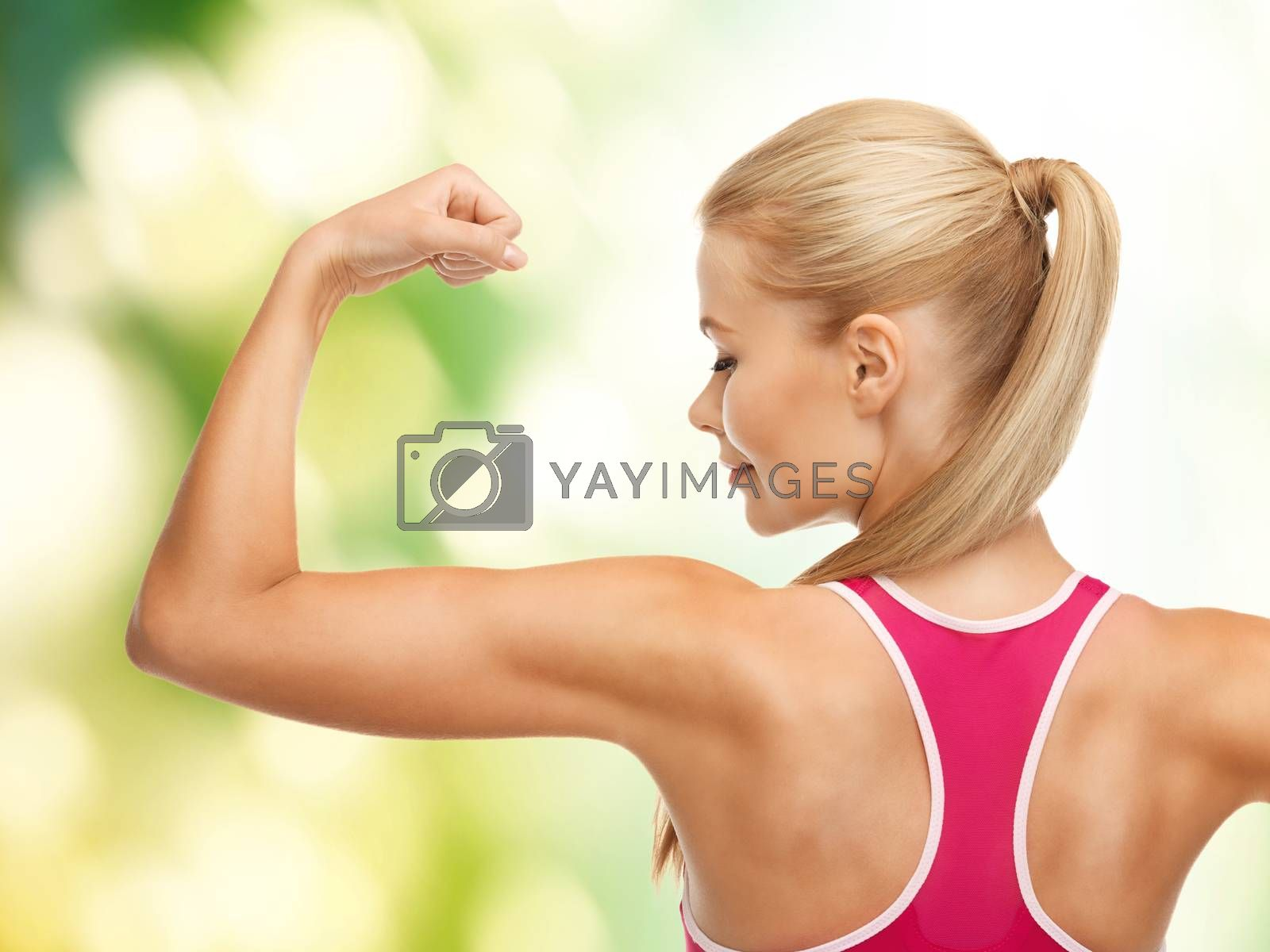 sporty woman showing her biceps by dolgachov
