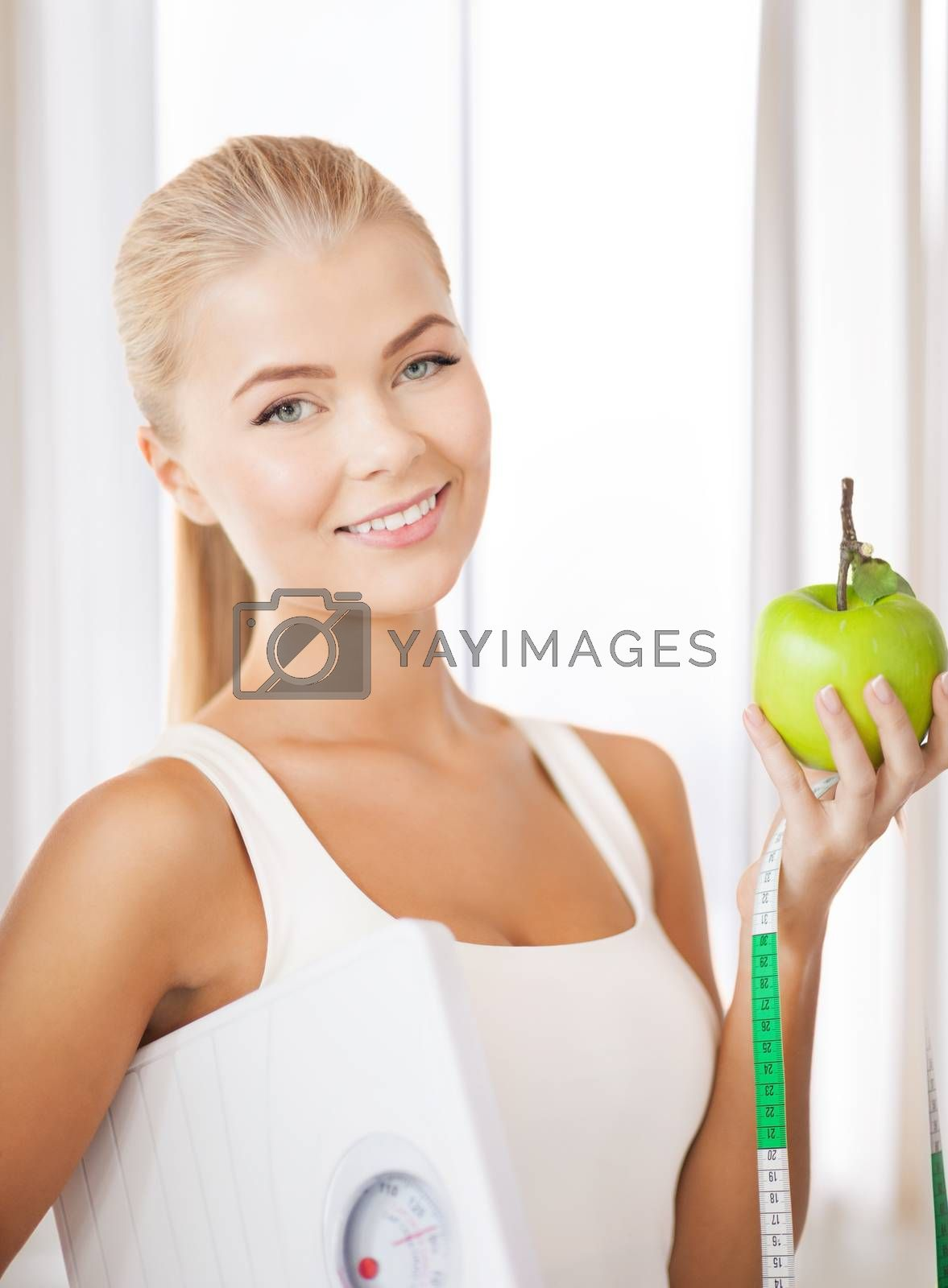 sporty woman with scale, apple and measuring tape by dolgachov