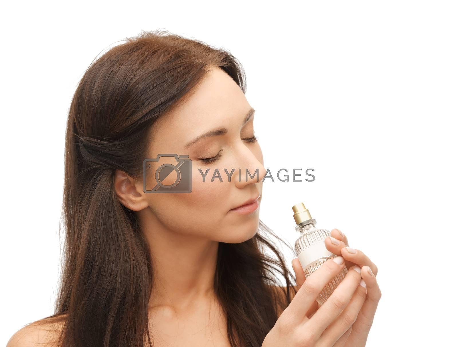 woman smelling perfume by dolgachov
