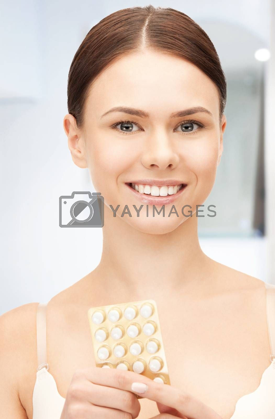 young beautiful woman with pills by dolgachov