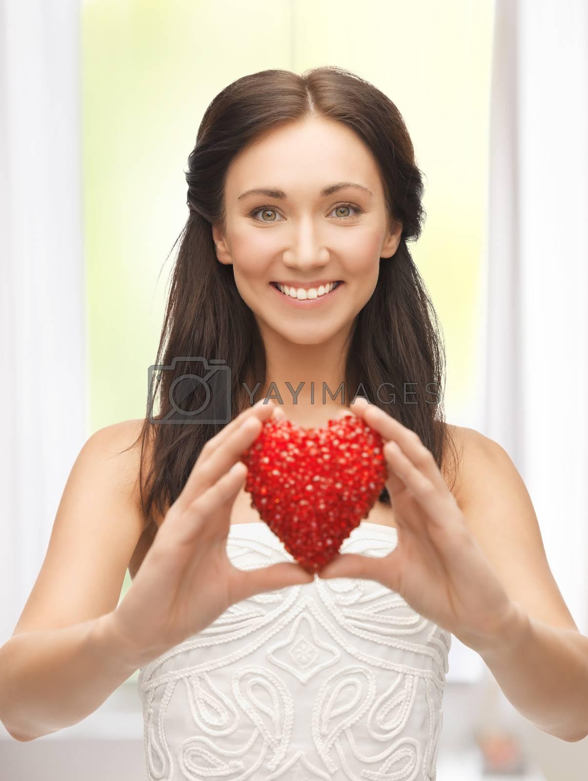 woman showing heart shape by dolgachov