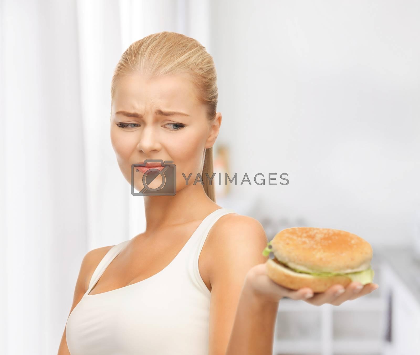 woman rejecting junk food by dolgachov