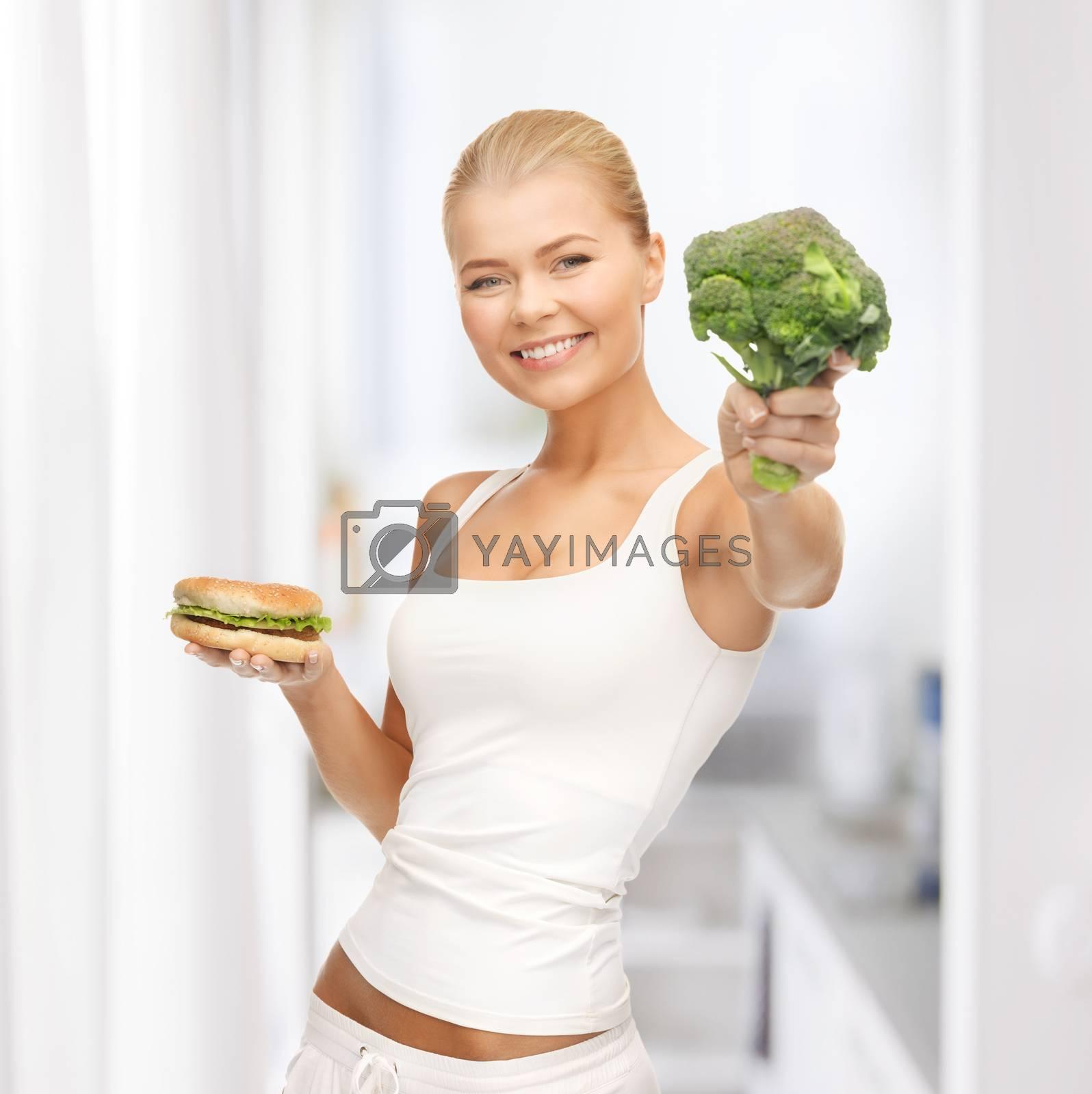 woman with broccoli and hamburger by dolgachov