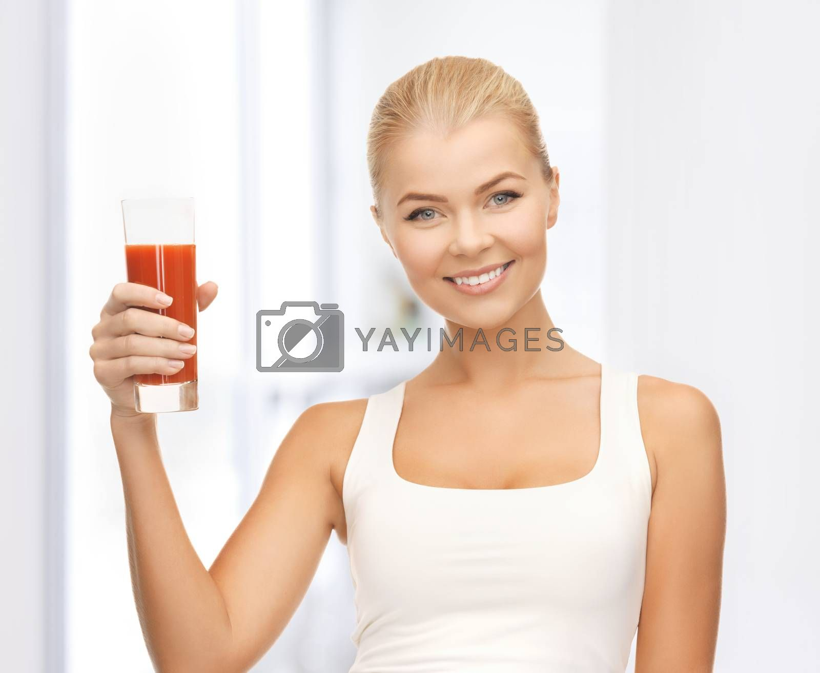 woman holding glass of tomato juice by dolgachov