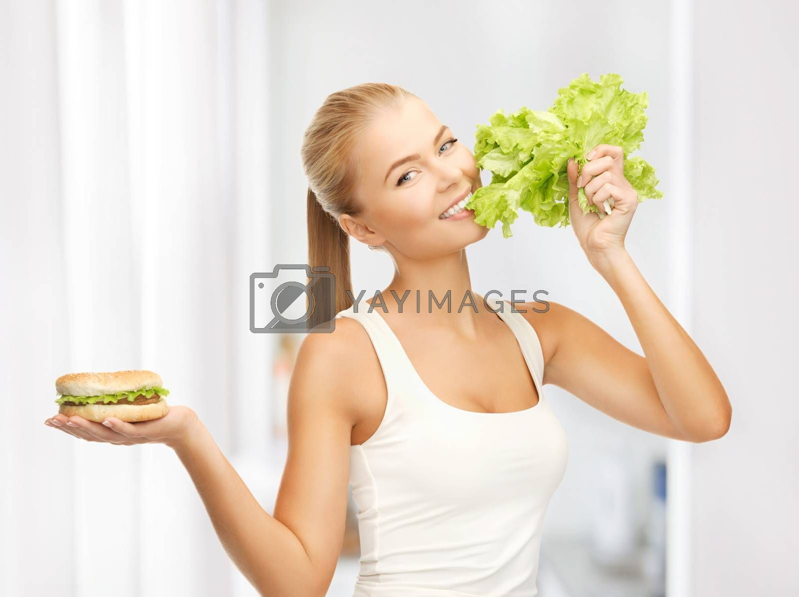 woman with green lettuce and hamburger by dolgachov