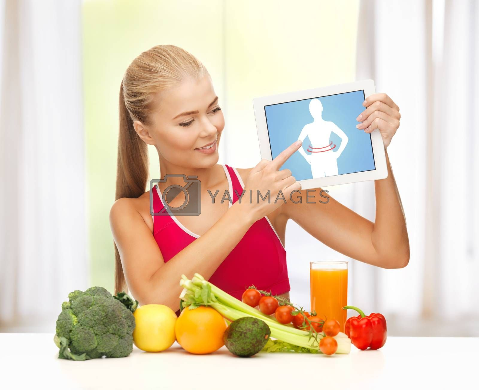 woman with fruits, vegetables and tablet pc by dolgachov