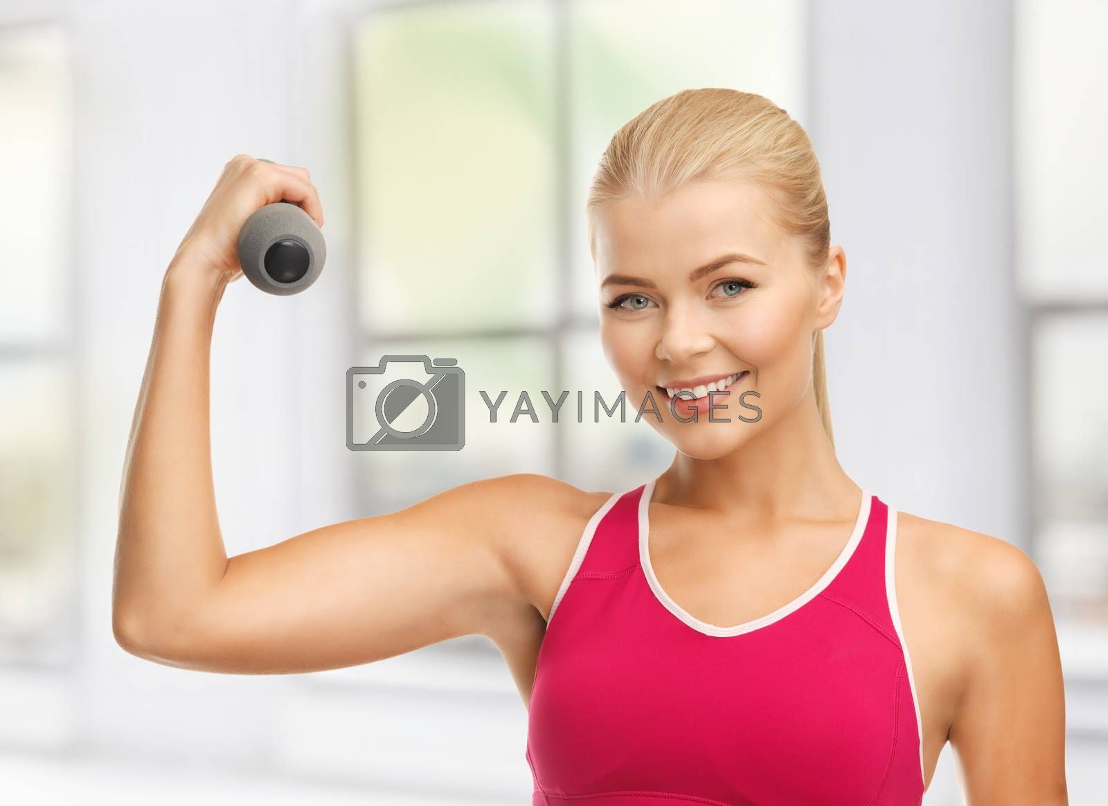 young sporty woman with light dumbbell by dolgachov