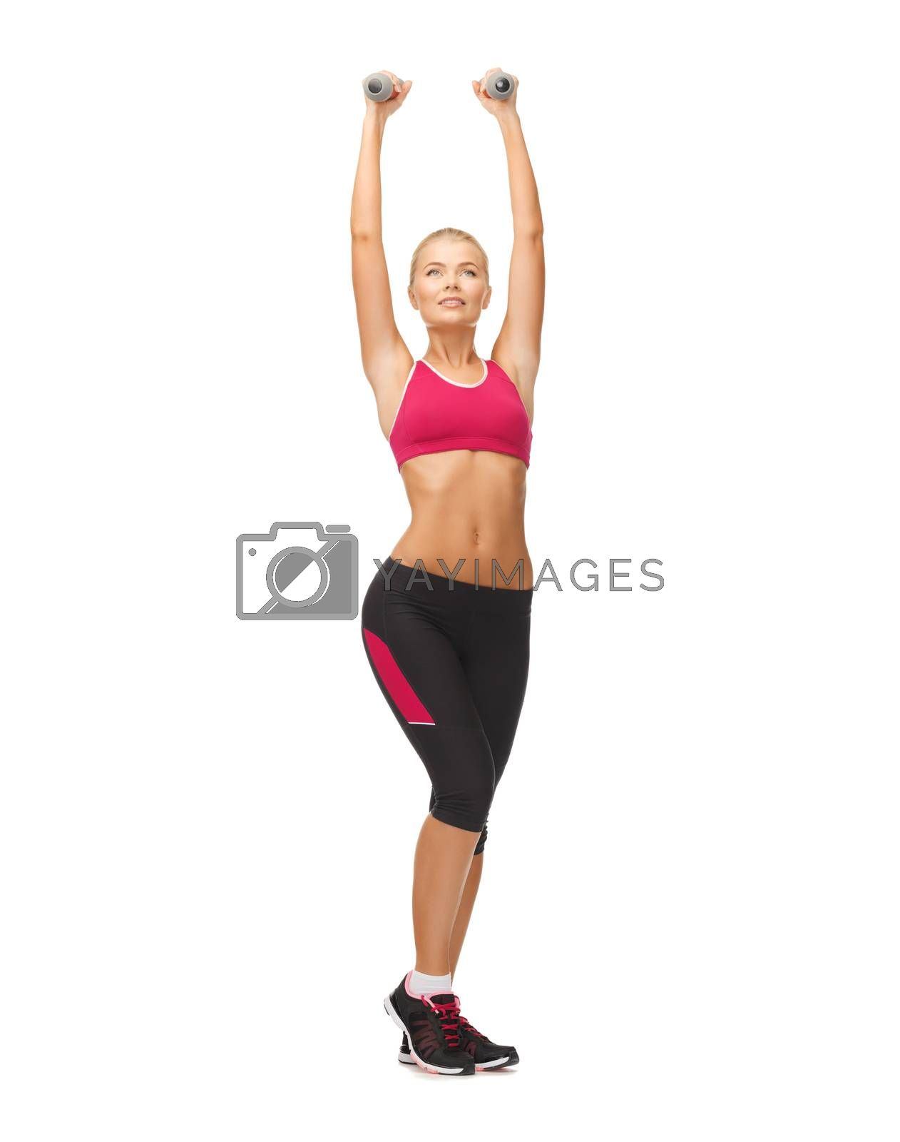 young sporty woman with light dumbbells by dolgachov
