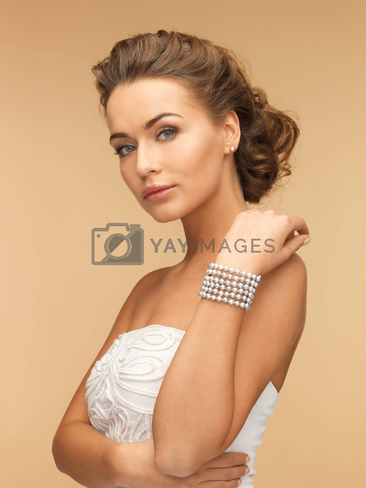 woman with pearl earrings and bracelet by dolgachov