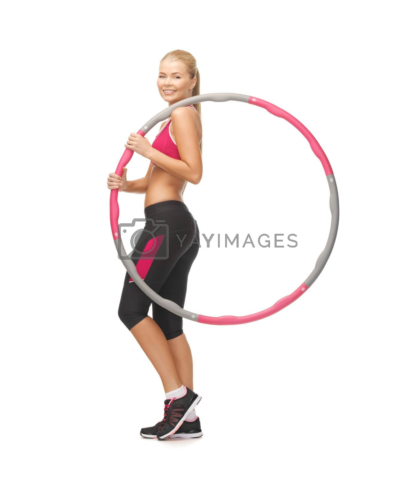 young sporty woman with hula hoop by dolgachov