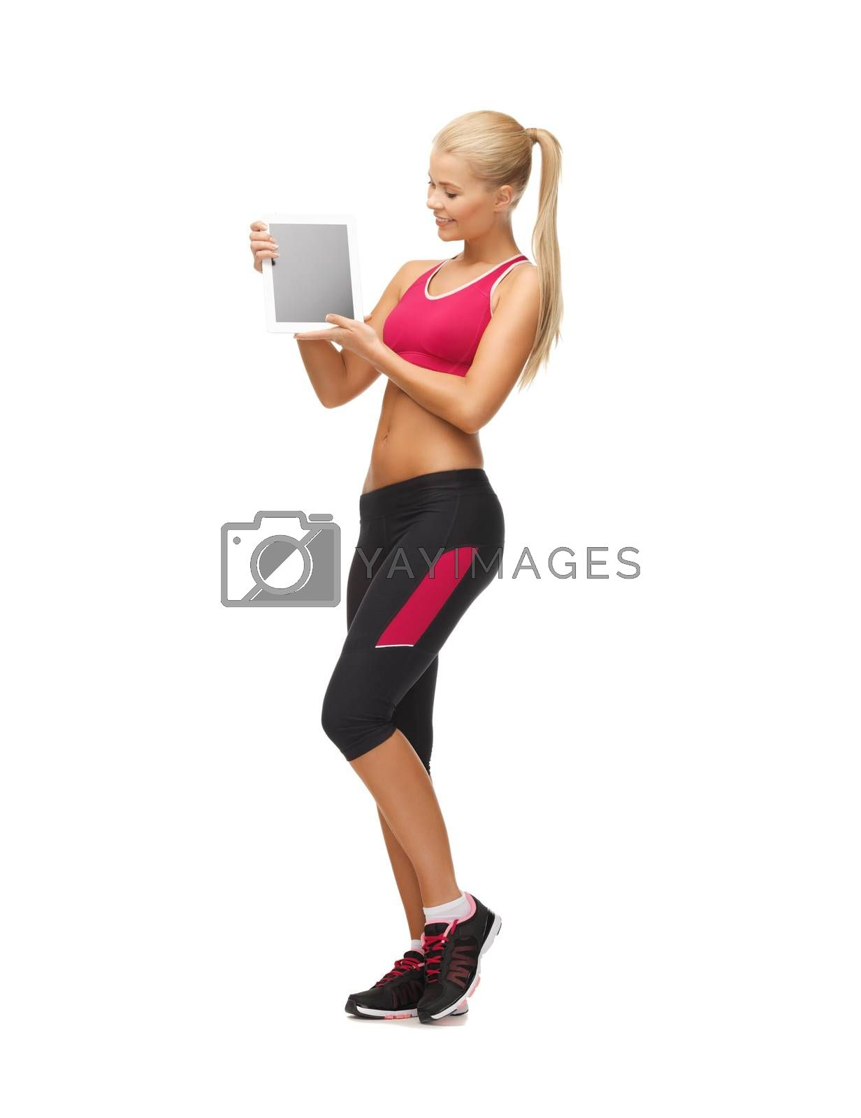 sporty woman with tablet pc by dolgachov