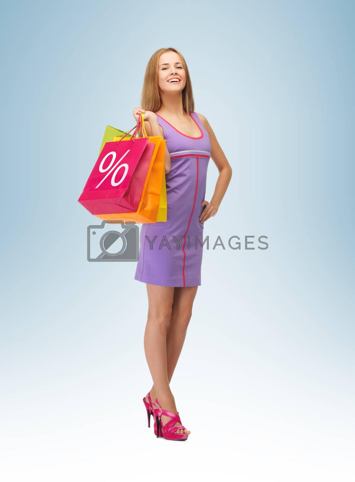 woman carrying shopping bags by dolgachov
