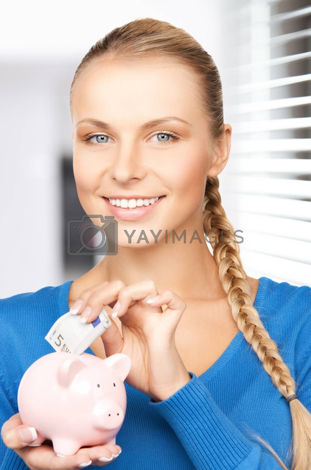 lovely woman with piggy bank and money by dolgachov