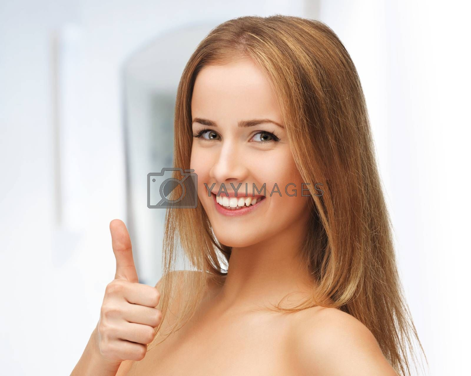 beautiful woman showing thumbs up by dolgachov