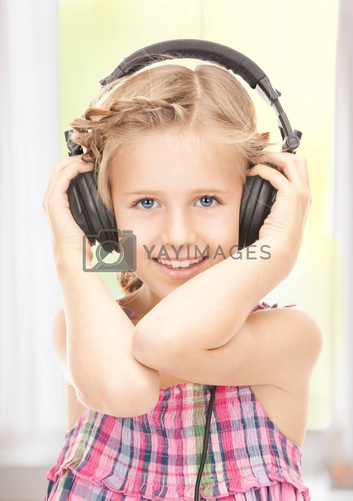 happy girl in big headphones by dolgachov