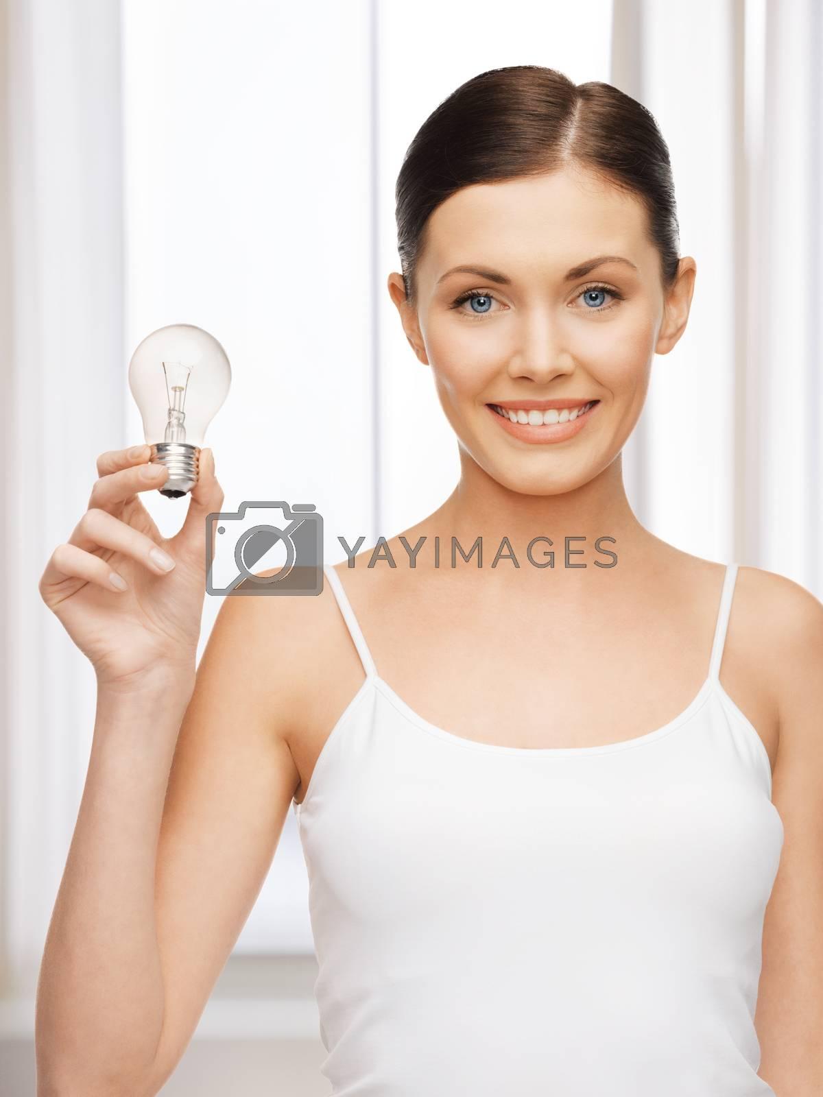 woman with energy saving bulb by dolgachov
