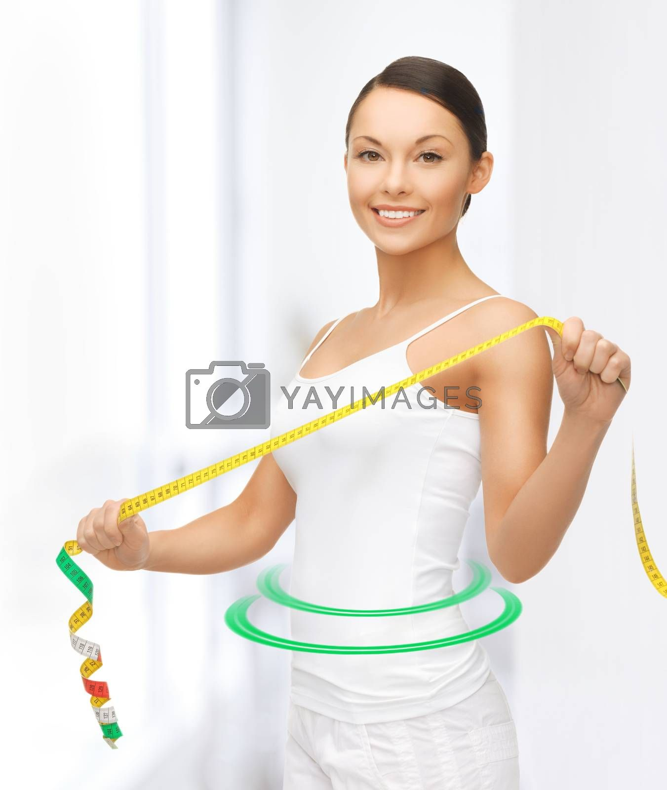 sporty woman with measuring tape by dolgachov