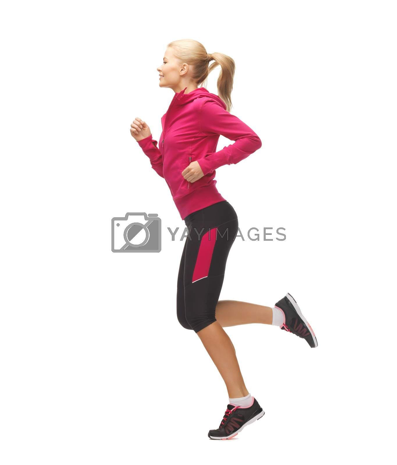 sporty woman running or jumping by dolgachov