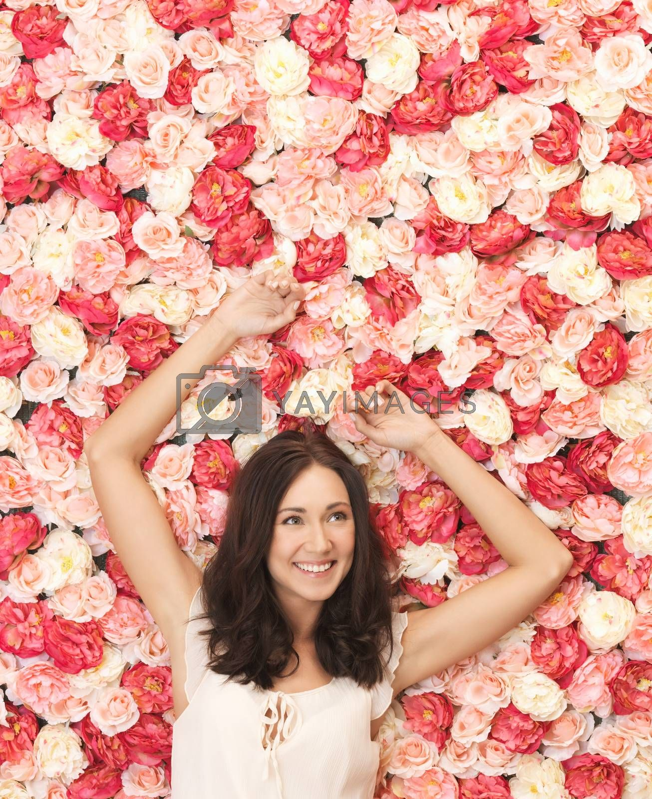 beautiful woman and background full of roses by dolgachov