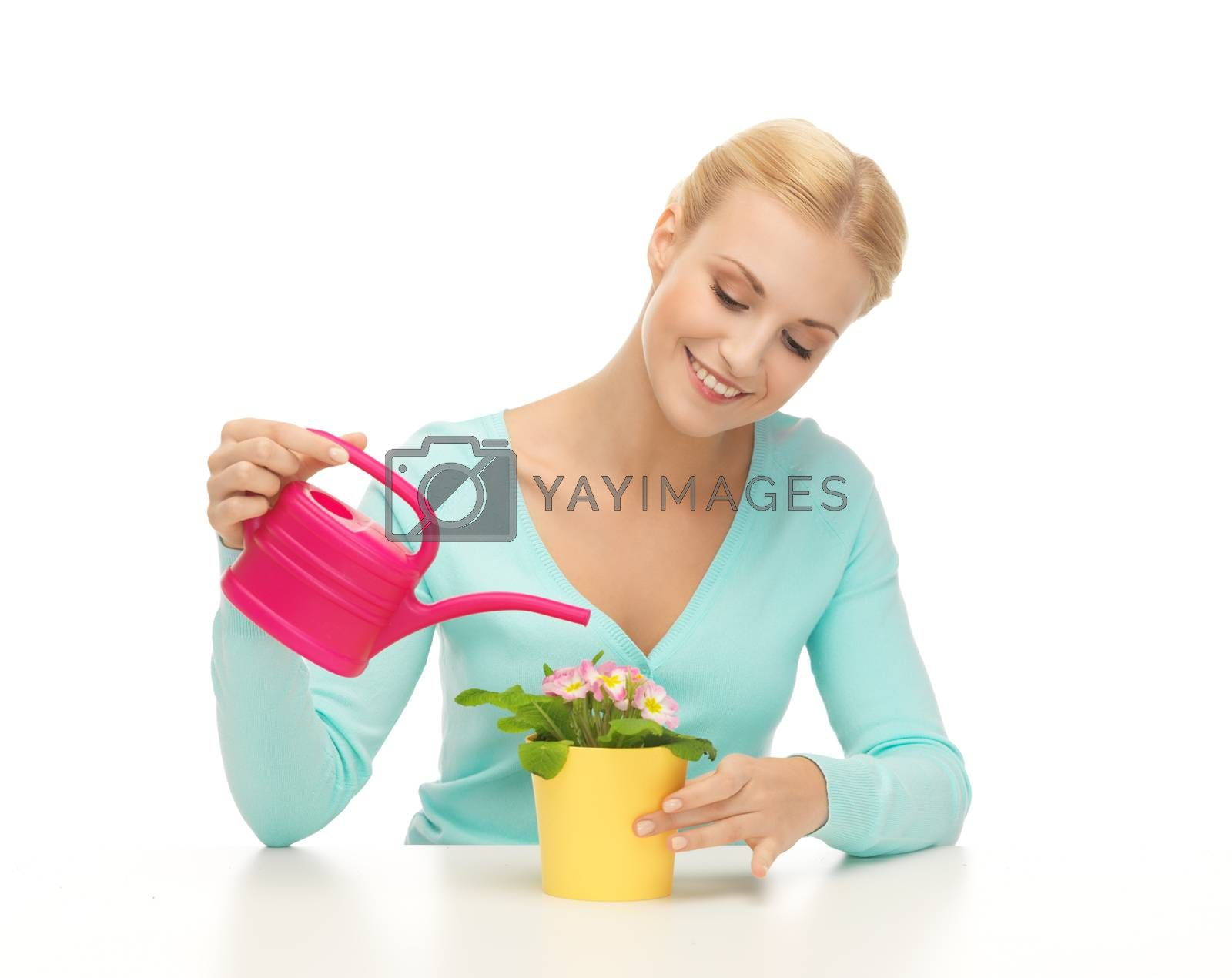 housewife with flower in pot and watering can by dolgachov