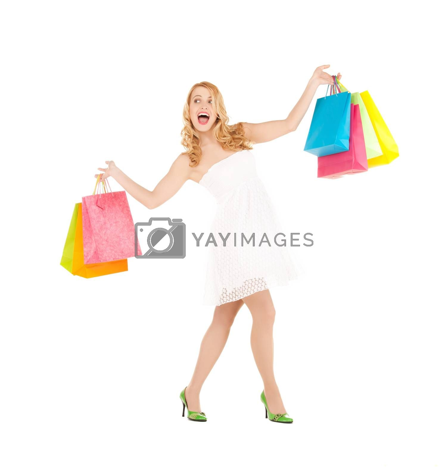 woman with shopping bags by dolgachov