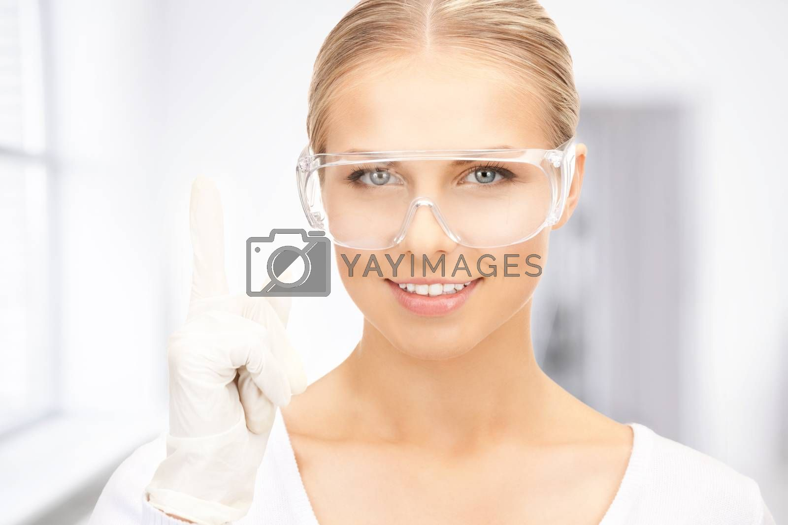 woman in protective glasses and gloves by dolgachov