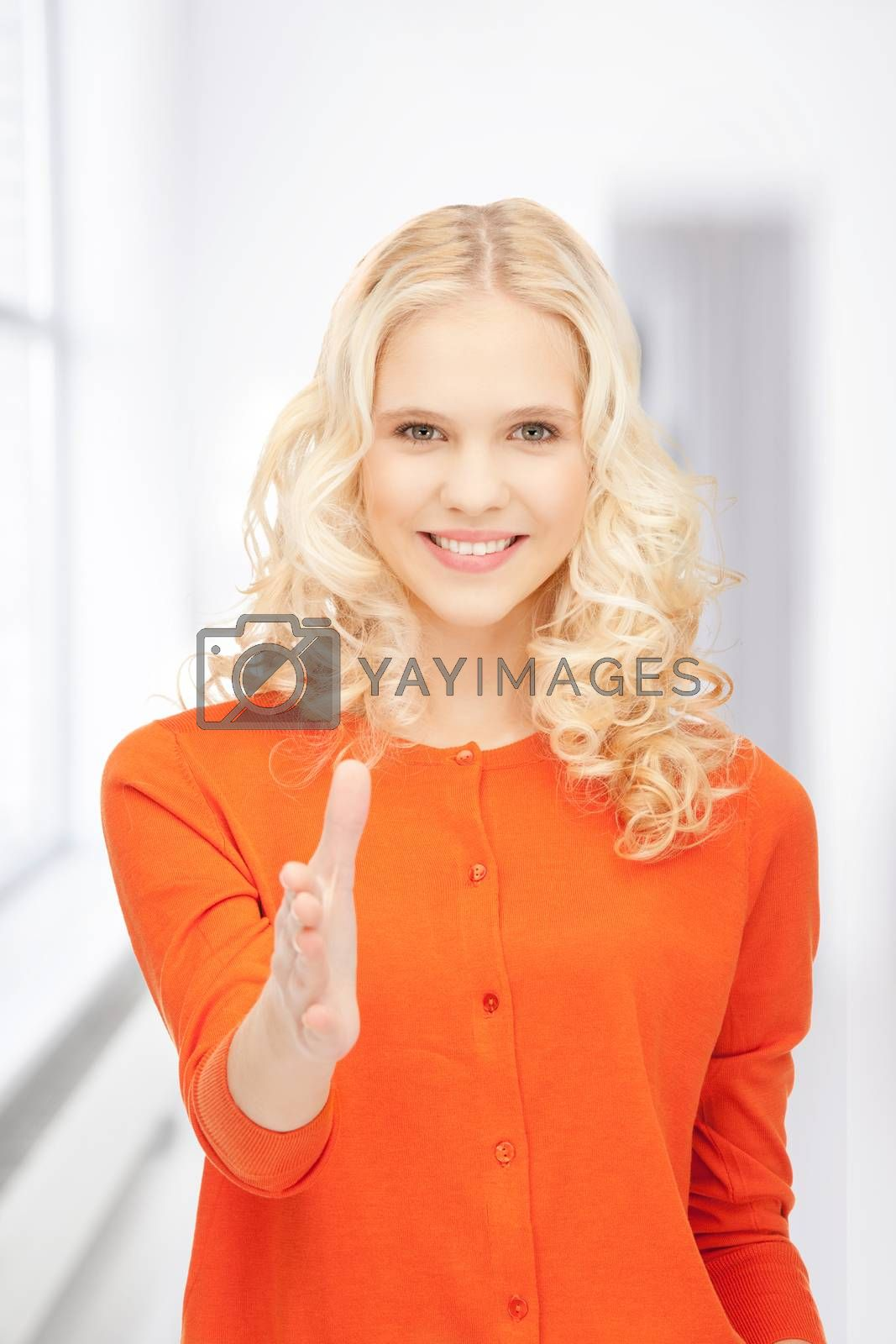 woman with an open hand ready for handshake by dolgachov