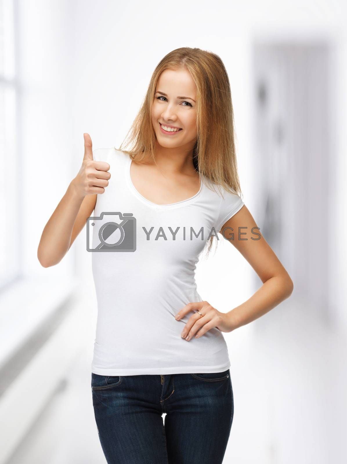 teenage girl in blank white t-shirt with thumbs up by dolgachov