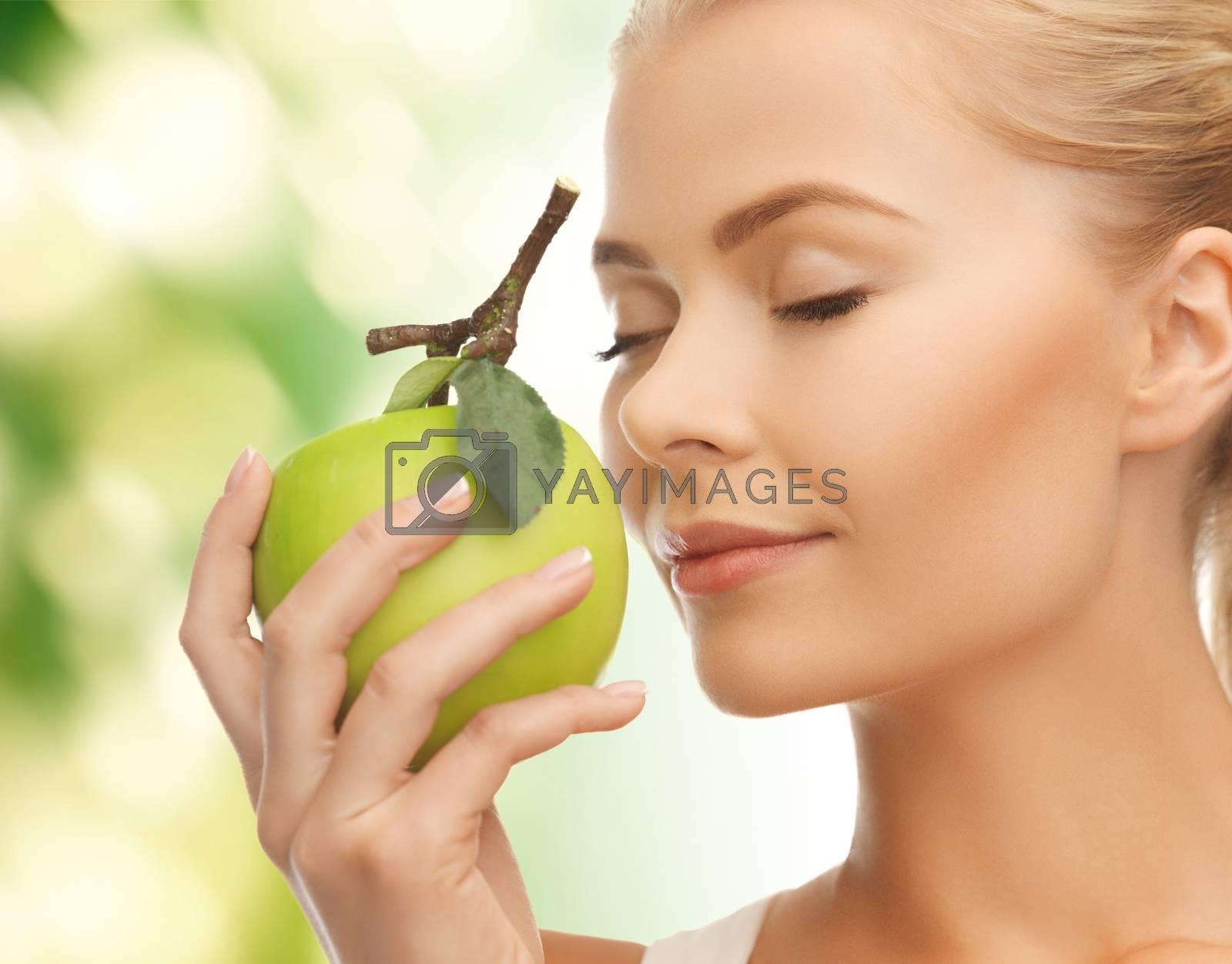 woman smelling apple by dolgachov