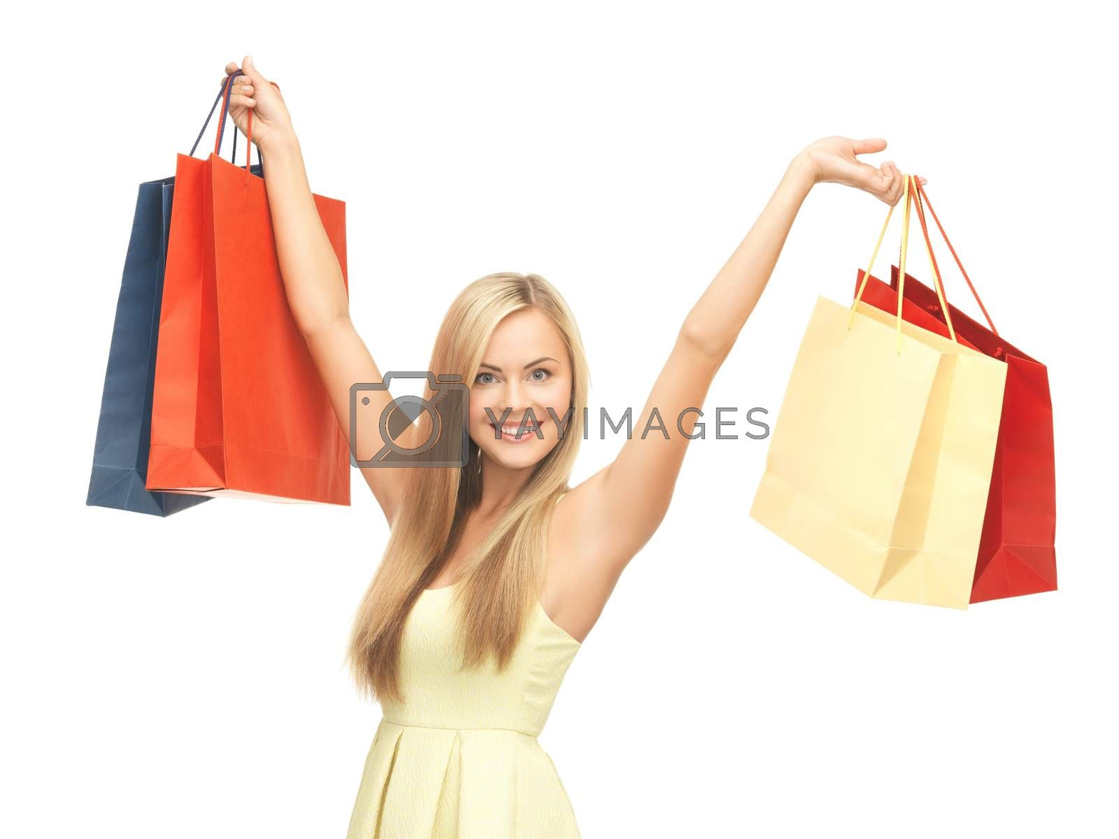 excited woman with shopping bags by dolgachov