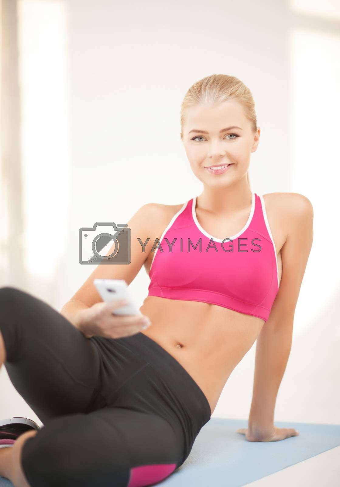 woman sitting on the floor with smartphone by dolgachov