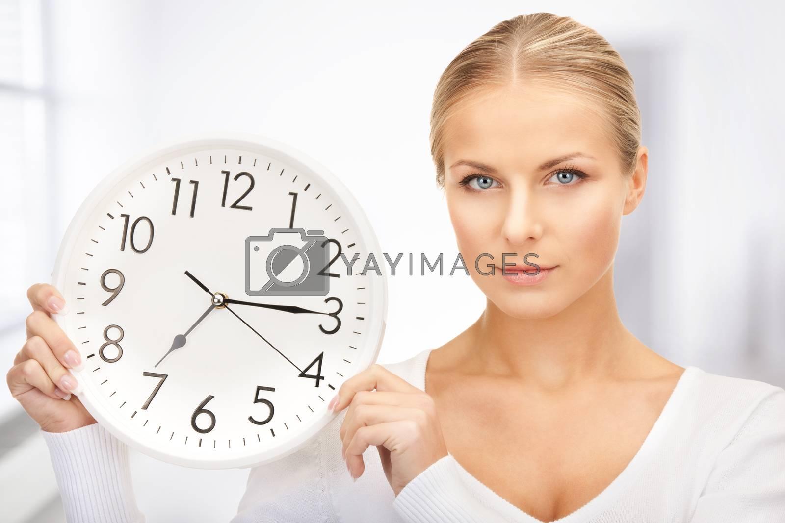 woman holding big clock by dolgachov