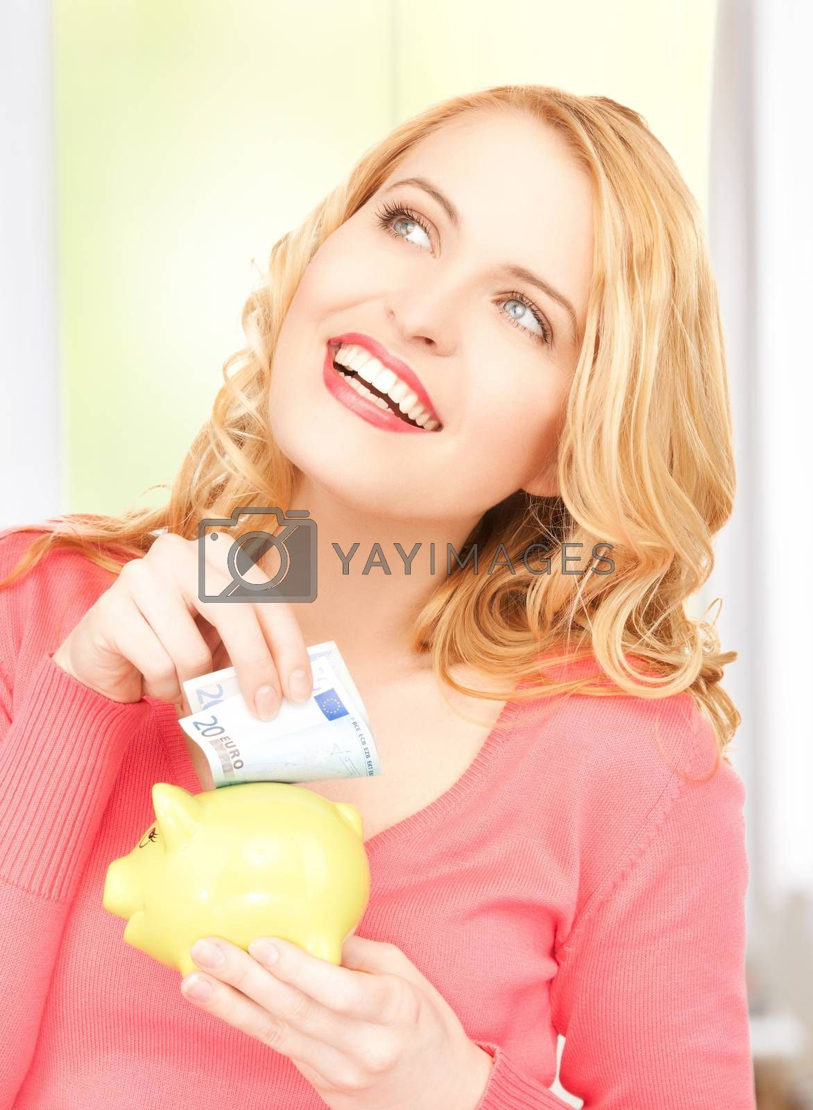 woman with piggy bank and cash money by dolgachov