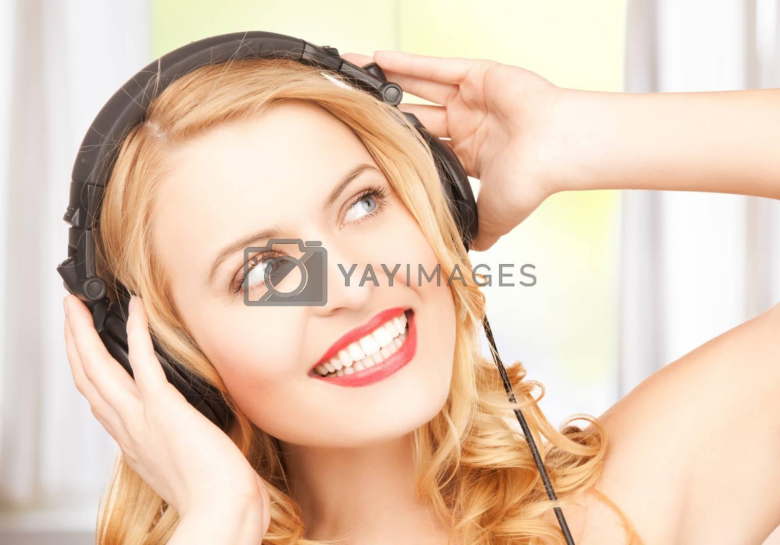 woman with headphones by dolgachov