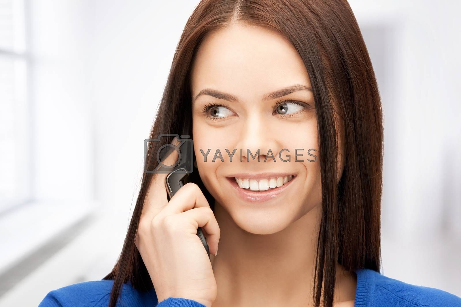 businesswoman with cell phone by dolgachov