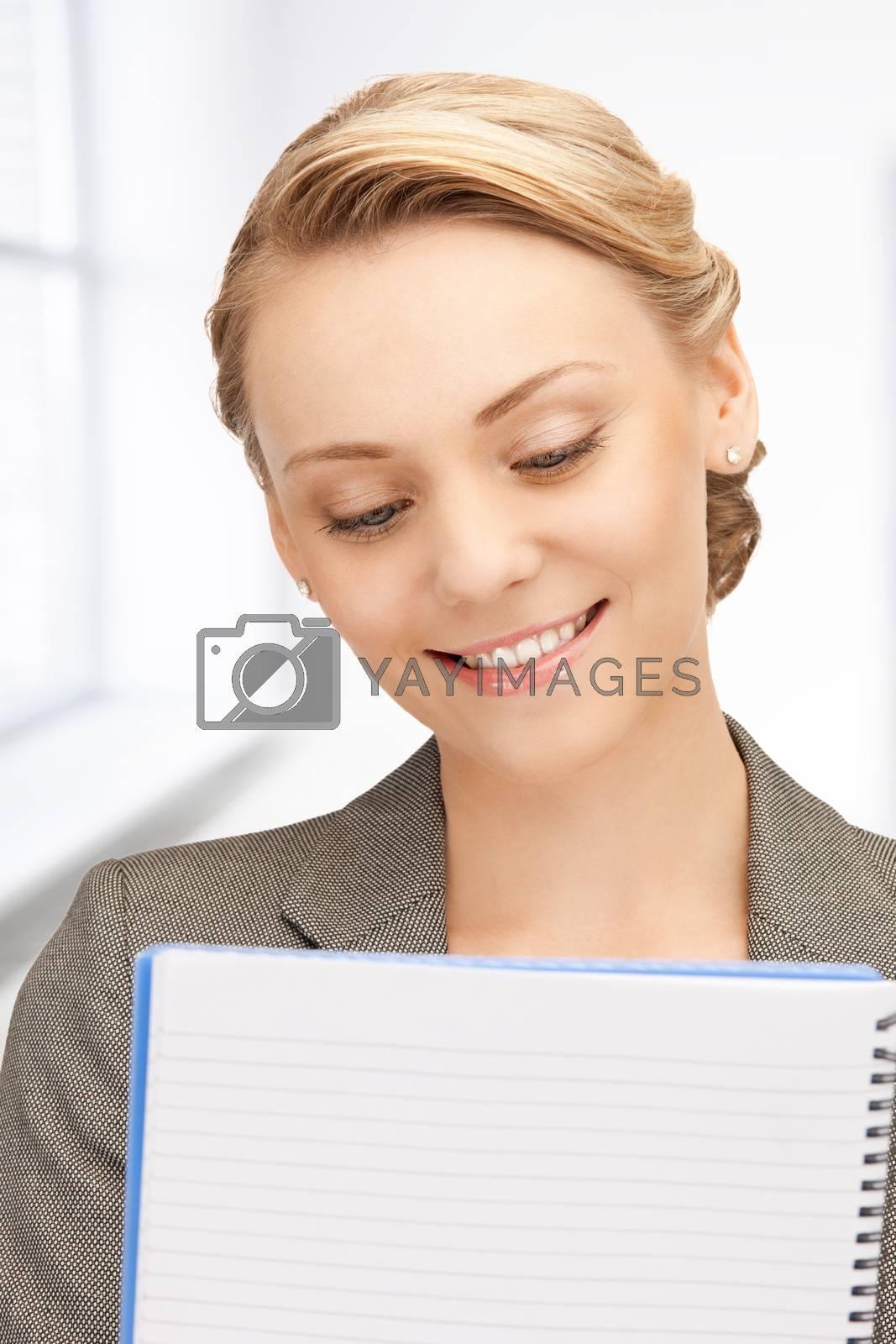 happy woman with big notepad by dolgachov