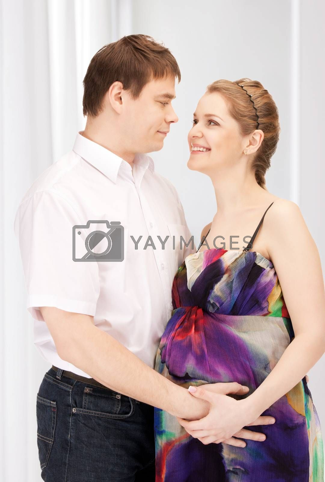 pregnant couple waiting for baby by dolgachov